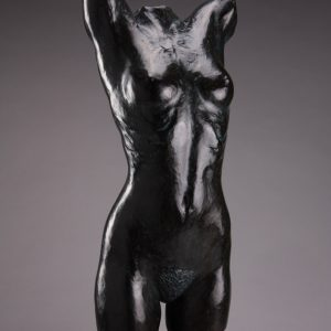 Entitled Jennifer, this is a photograph depicting a life-size bronze sculpture of a standing female figure, created by sculptor Blake Ward