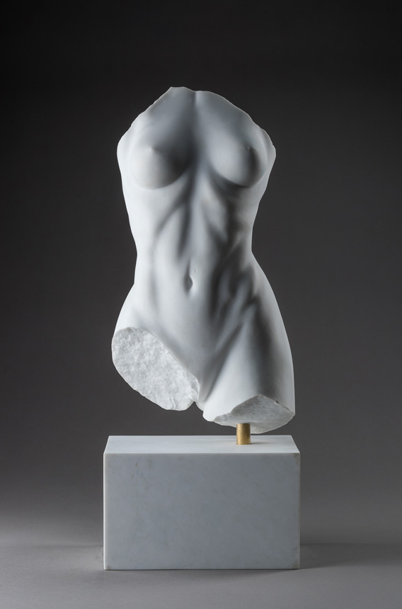 Entitled Maya, this is a photograph depicting a one-quarter life-size sculpture of a partial female torso in marble, created by sculptor Blake Ward
