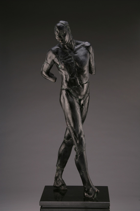 Entitled ADAM M-72, this is a photo of a fragment of a one-quarter life size bronze sculpture. Depicted is standing nude male figure missing his feet, left and right arm below the elbow. By sculptor Blake Ward.