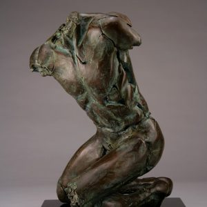 Entitled Butterfly PFM1, this is a photo of a fragment of a one-quarter life size bronze sculpture. Depicted is kneeling nude male figure missing his feet, arms, neck and head. By sculptor Blake Ward.