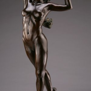 Entitled Flamenco, this is a photograph depicting a one-quarter life-size bronze sculpture of a standing female figure, created by sculptor Blake Ward