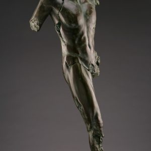 Entitled Maped F1, this is a photo of a fragment of a one-quarter life size bronze sculpture. Depicted is a standing nude male figure missing his left leg at the hip and right leg below the knee, both arms and head. By sculptor Blake Ward