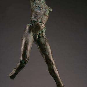 Entitled MON-50, this is a photo of a fragment of a one-quarter life size bronze sculpture. Depicted is standing nude female figure missing both her feet, both arms and head. By sculptor Blake Ward.