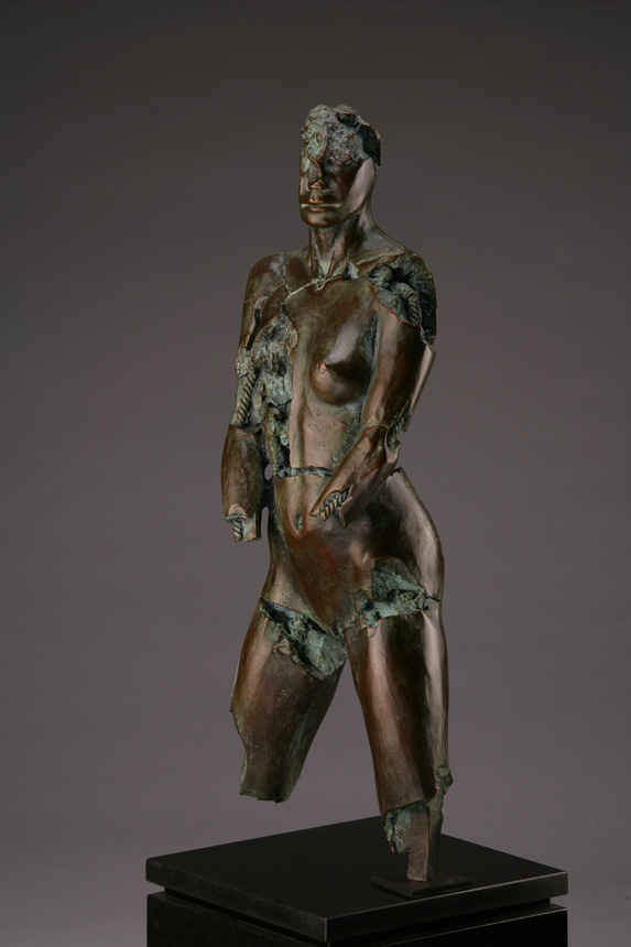 Entitled Sadeye CBU-75, this is a photo of a fragment of a one-quarter life size bronze sculpture. Depicted is the torso of a nude female figure missing her legs from the knee and her hands. By sculptor Blake Ward.