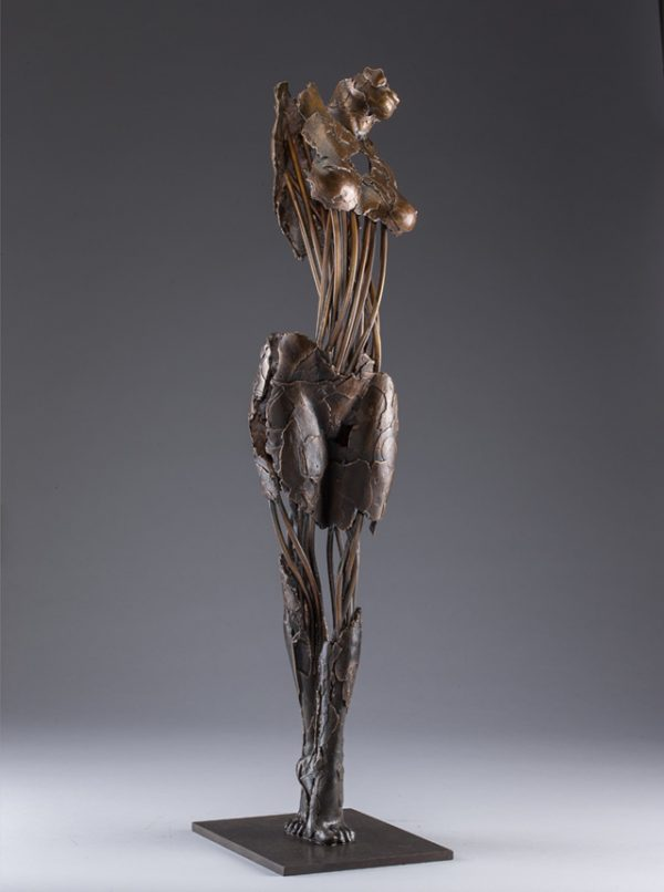 Entitled Ushabti Ryuu, this is a bronze sculpture of a partial female figure with an exposed interior structure created by sculptor Blake Ward.