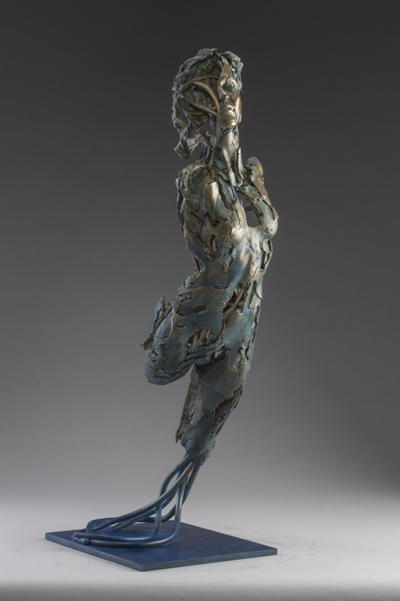 Entitled Angel Bahram, this is a bronze sculpture of a partial female figure with an exposed interior structure by Blake Ward