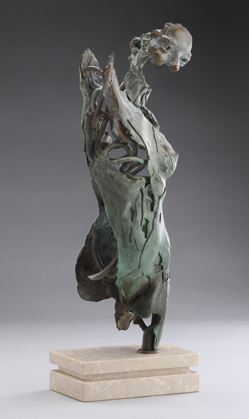 Entitled Angel Vohamanah, this is a bronze sculpture of a partial female figure with an exposed interior structure created by sculptor Blake Ward.