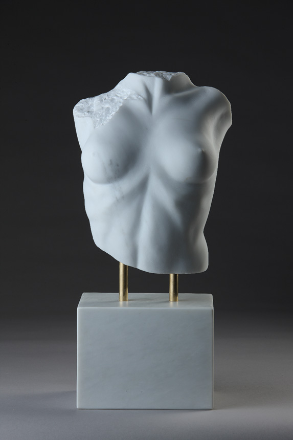 Entitled Lora From Another Land, this is a photograph depicting a one-quarter life-size sculpture of a partial female torso in marble, created by sculptor Blake Ward