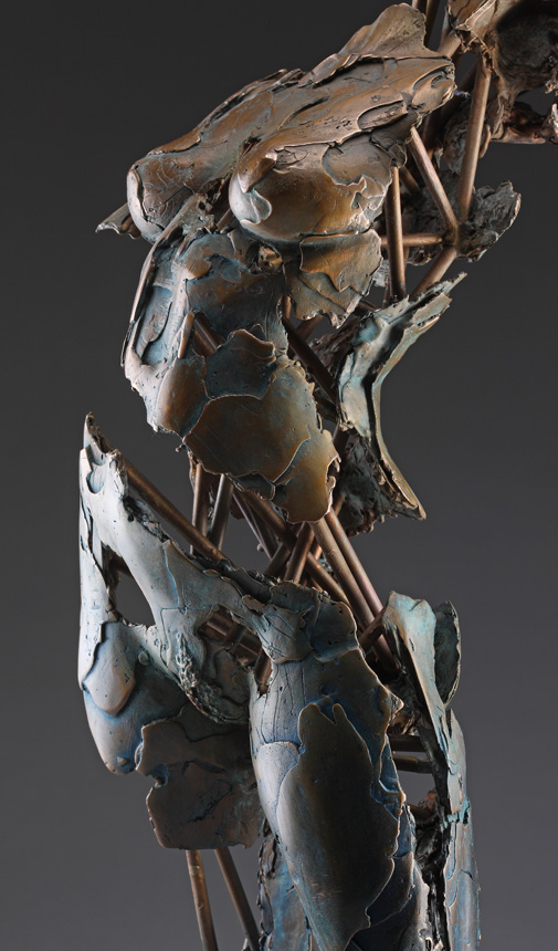 Entitled Archangel Chamuel, this is a bronze sculpture of a partial female figure with an exposed interior structure created by sculptor Blake Ward