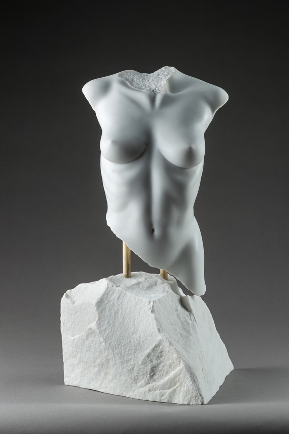 Entitled Adonael, this is a photograph depicting a one-quarter life-size sculpture of a partial female torso in marble, created by sculptor Blake Ward