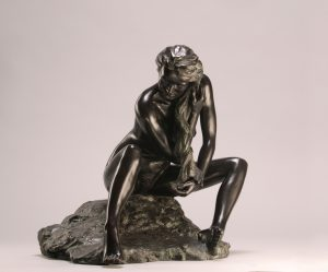 Entitled The Bather, this is a photograph depicting a one-quarter life-size bronze sculpture of a sitting female figure, created by sculptor Blake Ward