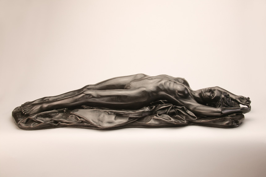 Entitled L'Abandon, this is a photograph depicting a one-quarter life-size bronze sculpture of a laying female figure, created by sculptor Blake Ward