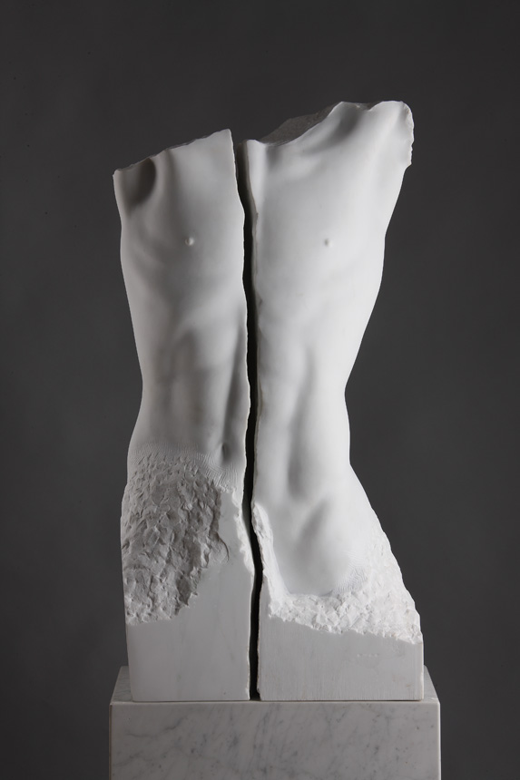 Entitled Faith, this is a photograph depicting a life-size marble sculpture of a male torso with a crack running lengthwise through the middle, created by sculptor Blake Ward