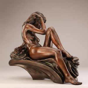 Entitled La Notte, this is a photograph depicting a one-quarter life-size bronze sculpture of a sitting female figure, created by sculptor Blake Ward