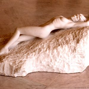 Entitled Lawrence, this is a photograph depicting a one-quarter life-size marble sculpture of a laying female figure, created by sculptor Blake Ward