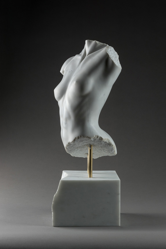 Entitled Miniel, this is a photograph depicting a one-quarter life-size marble sculpture of a partial female torso, created by sculptor Blake Ward