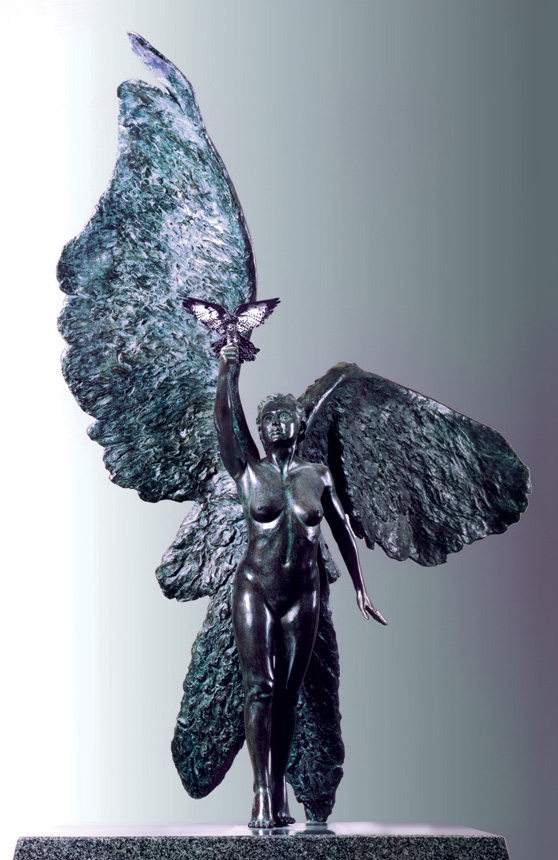 Entitled The Messenger, this is a photograph depicting a one-quarter life-size bronze sculpture of a standing winged female figure, created by sculptor Blake Ward