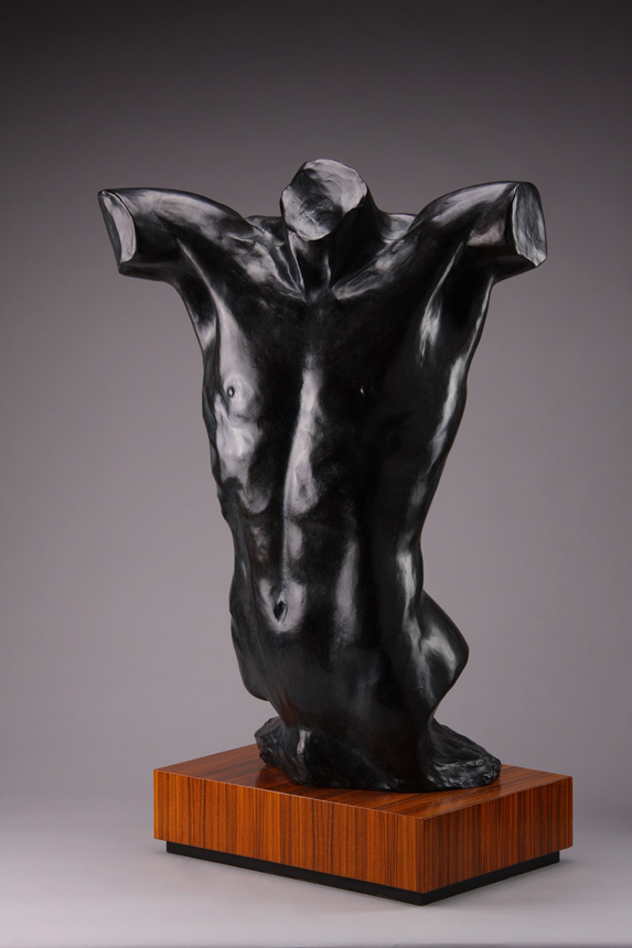 Entitled Vincent, this is a photograph depicting a life-size bronze sculpture of a standing male figure, created by sculptor Blake Ward