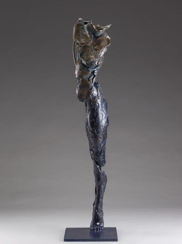 Entitled Ushabti Wenet this is a bronze sculpture of a partial female figure with an exposed interior structure created by sculptor Blake Ward.