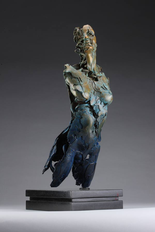 Entitled Angel Valoel, this is a bronze sculpture of a partial female figure with an exposed interior structure created by sculptor Blake Ward.