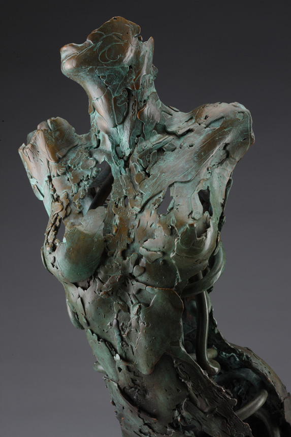 Entitled The Archangel Ramiel, this is a bronze sculpture of a partial female figure with an exposed interior structure created by sculptor Blake Ward