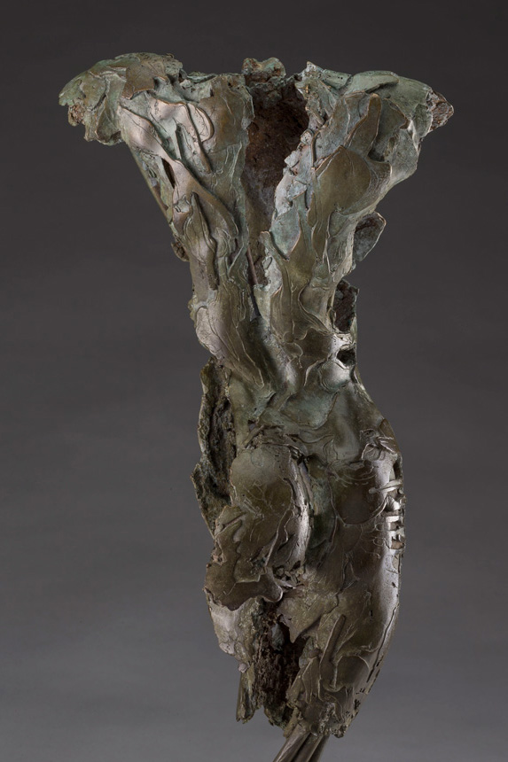 Angel Anthriel Photo of the back of a partial female figure in bronze with an exposed interior structure by Blake Ward Blake Sculpture